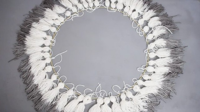 large hoop decorated with tassels, made from white yarn, and dip dyed in dark grey, bedroom makeover, how to make a tassel chandelier at home