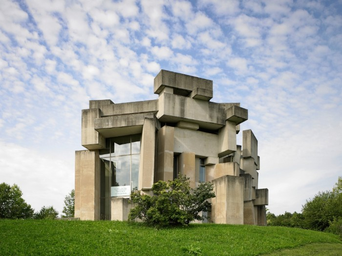 brutalism examples, the wotruba church, in vienna austria, asymmetrical concrete building, made up of many rectangular segments