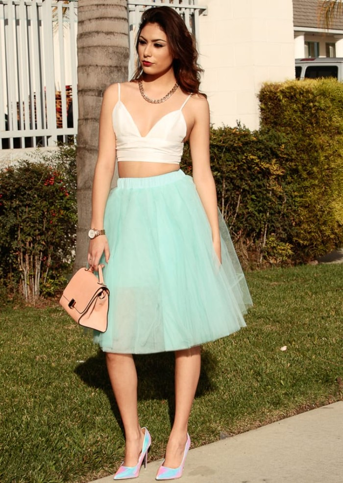 tulle knee length skirt, in light turquoise, combined with a white bralette, outfits with bralettes, small pale pink bag, and iridescent blue and pink high heel shoes
