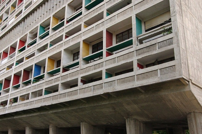 multicolored balconies on a grey concrete building, le corbusier's unité d'habitation, in marsille france