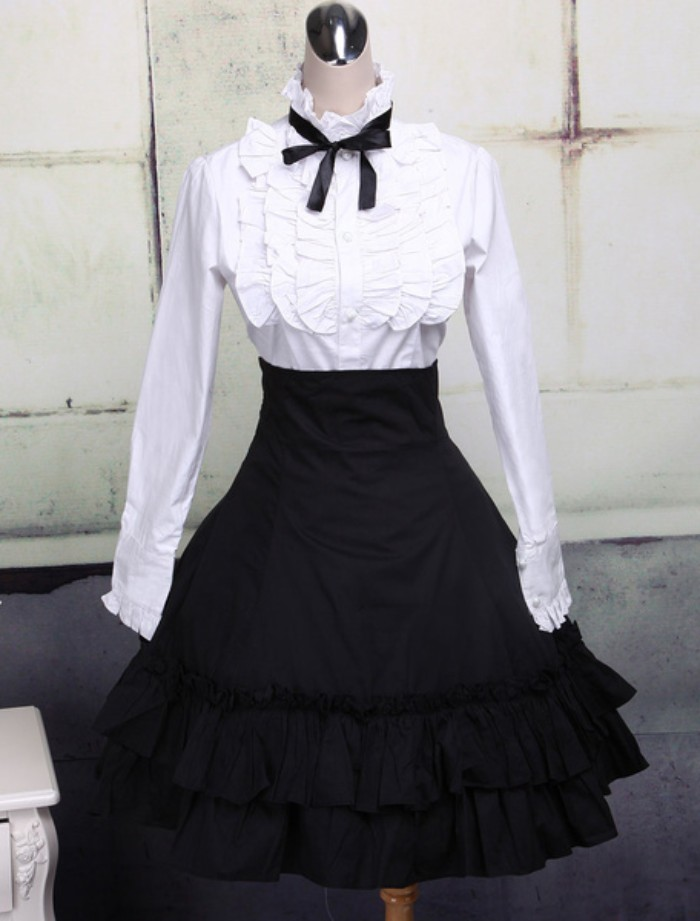 bib detail on a white shirt, featuring a black bow around the collar, define lolita, black frilled high-waisted skirt