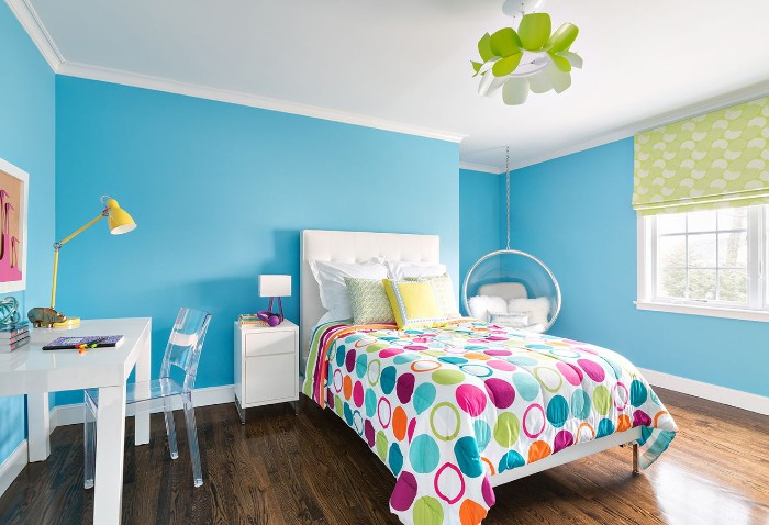 desk in white, and a clear plastic shair, in a room with blue walls, and a white ceiling, teenage bedroom ideas for small rooms, single bed with a colorful duvet