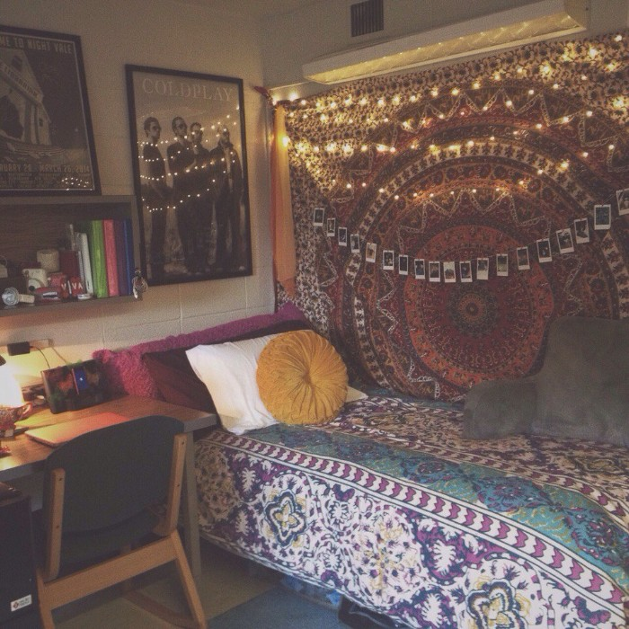 mandala motif on a large, fabric wall hanging, decorated with lit fairy lights, and multiple small photos on a string, teenage bedroom ideas for small rooms, single bed and a desk with a chair