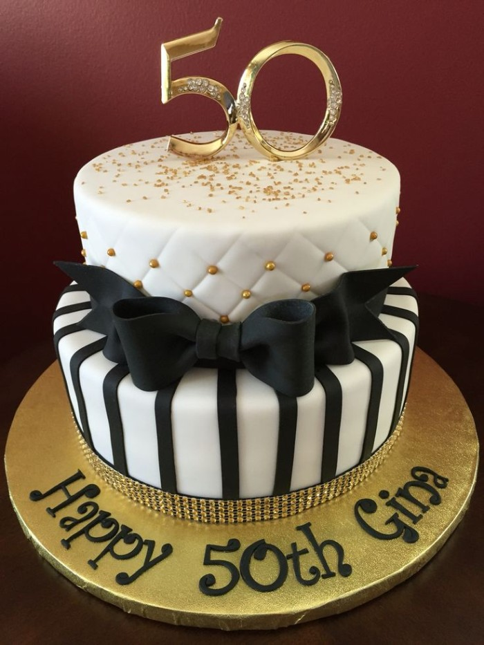 Happy 50th Gina Written In Black On A White And Gold Cake Decorated With Creative Birthday Party Ideas