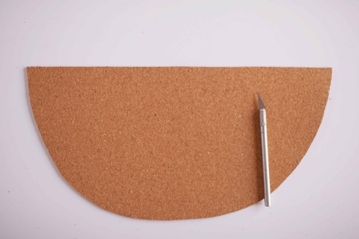 piece of beige cork, shaped like half a circle, placed on a white surface, cheap ways to decorate a teenage girl's bedroom, cutting cork with a box knife
