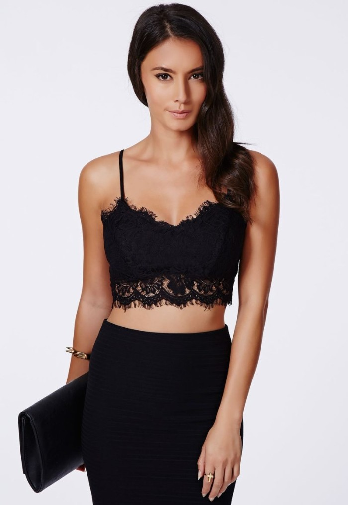 pencil skirt in black, and a black lace bralette, worn by a slim, young brunette woman, holding a black clutch bag, how to wear a bralette