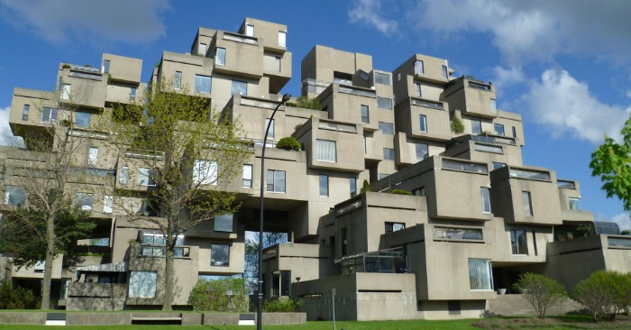 habitat 67 in motreal canada, large concrete building, made of multiple box-like structures, with rectangular windows, brutalism