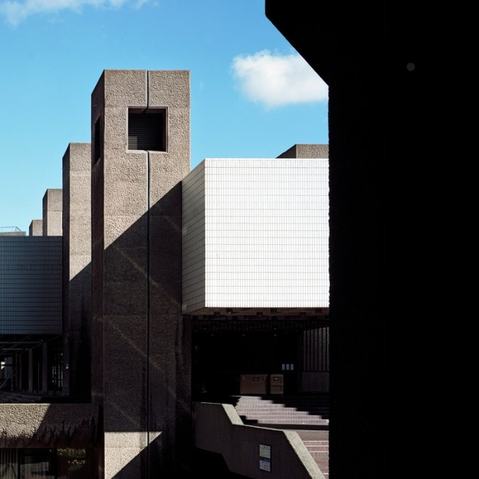 the barbican centre, in london england, examples of brutalism, building with rectangular shapes, covered in concrete and white tiles