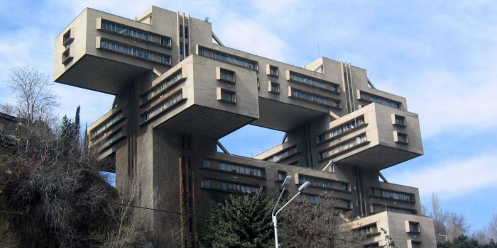 the headquarters of the bank of georgia, brutalist architecture example, tall concrete building, made up of crossing rectangular segments