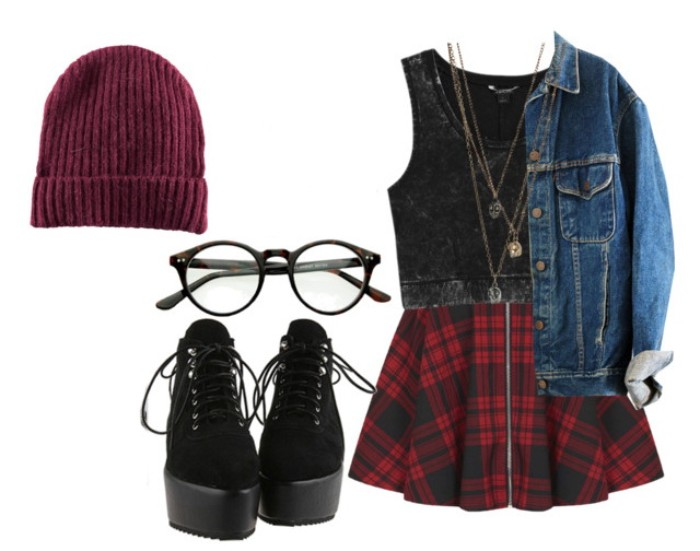 lace-up combat boots in black, with platform heels, a pair of glasses, ribbed burgundy beanie hat, tartan skirt with zipper front detail, dark grey cropped top, and a blue denim jacket
