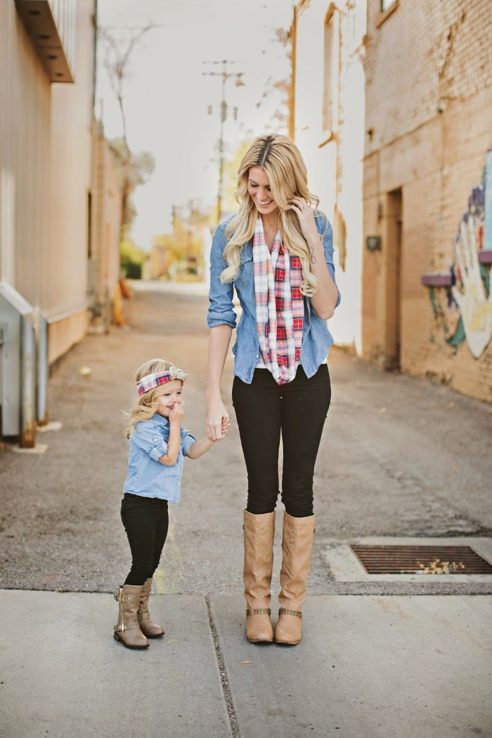 cute thanksgiving outfits, mother and small daughter, dressed in identical clothes, tall beige leather boots, black skinny jeans, light blue chambrays, and checkered scarves