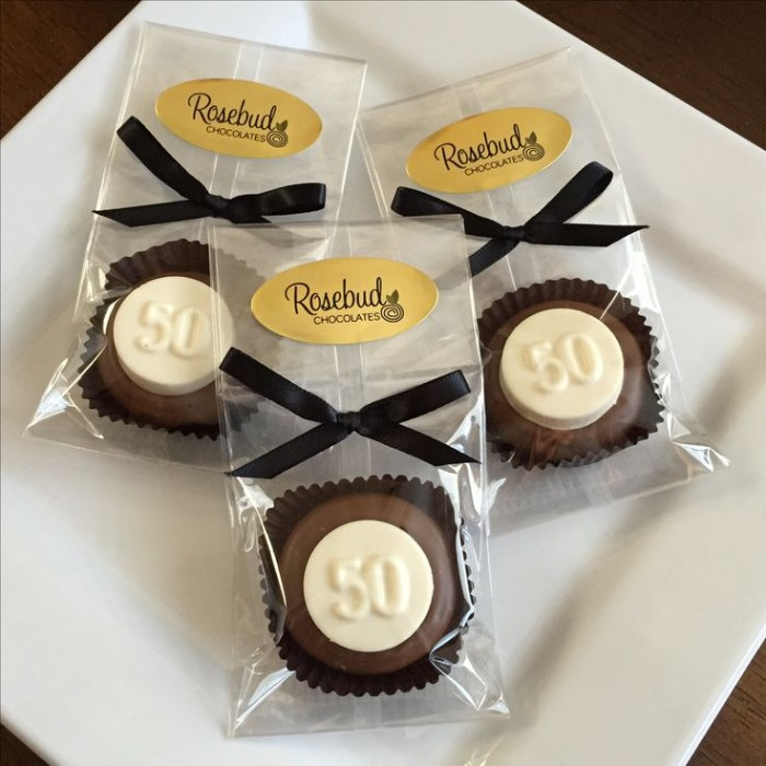 Individually Packaged Brown And White Chocolates Each Featuring The Number 50 A Black Creative 50th Birthday Party Ideas