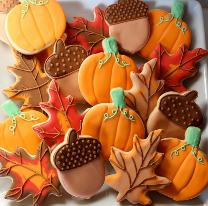 thanksgiving message to employees, cookies shaped like pumpkins, acorns and fall leaves, decorated with orange and beige, brown and green frosting
