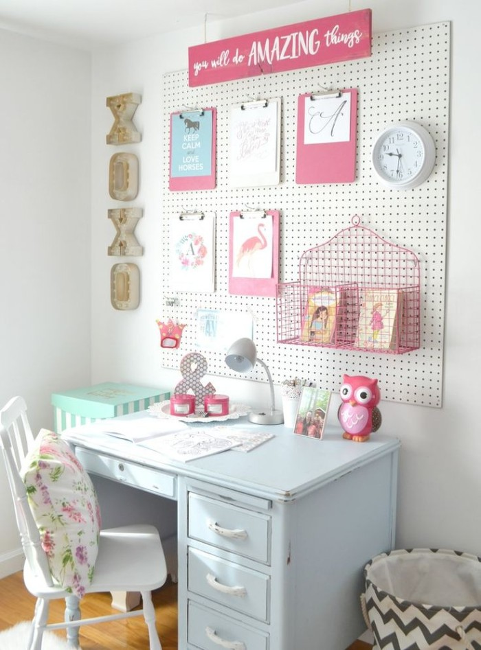 wall organizer in white and pink, on a white wall, near a pale blue retro desk, with a white vintage chair