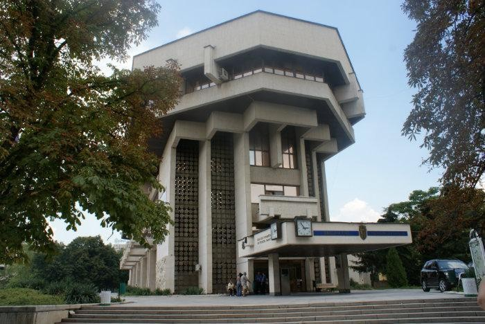 municipal building in ruse bulgaria, tall terraced concrete structure, with multiple reflective windows