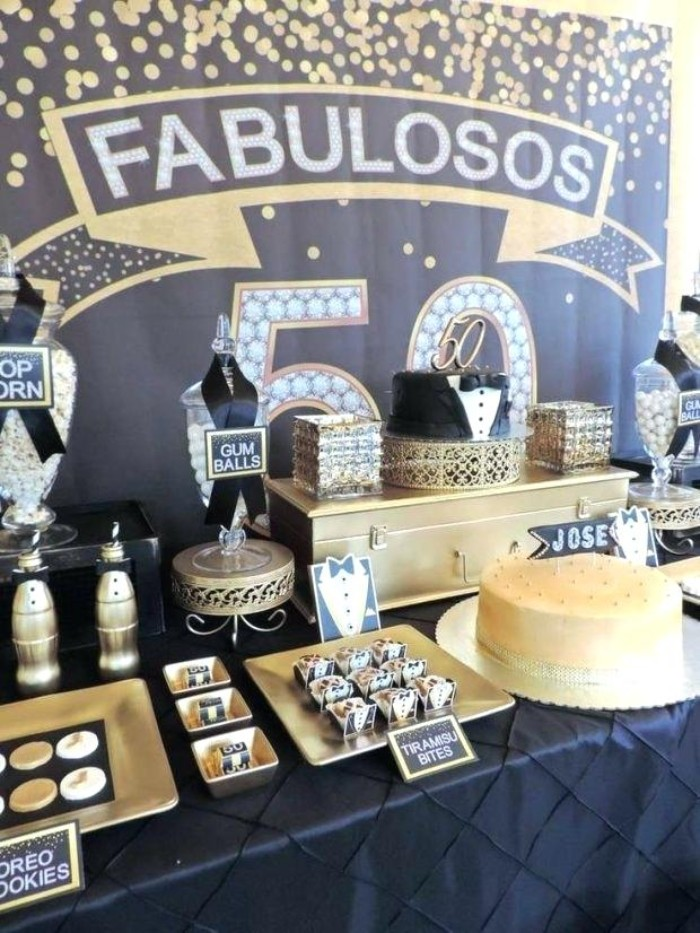 black and gold birthday theme, with small tuxedo decorations, and black ribbons, 50th birthday celebration ideas for husband, table with a selection of cakes and sweets