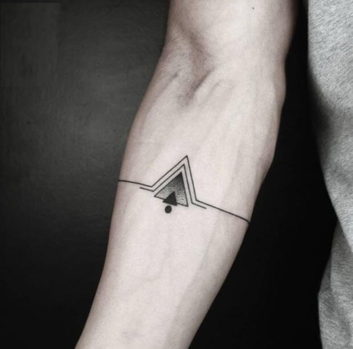 lines and triangles, in black and grey, and a single black dot, symmetrical cool arm tattoos, on the inside part of a man's arm, just below the elbow, best meaningful tattoo for men