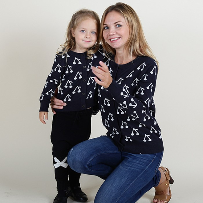 cherry print in white, on navy blue jumpers, worn by a mother and daughter duo, cute thanksgiving outfits, blue jeans and black and white trousers