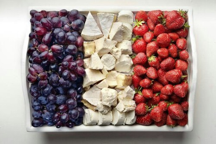 large white rectangular ceramic plate, containing black grapes, cheese and strawberries, 50th birthday party ideas, colorful canape ideas