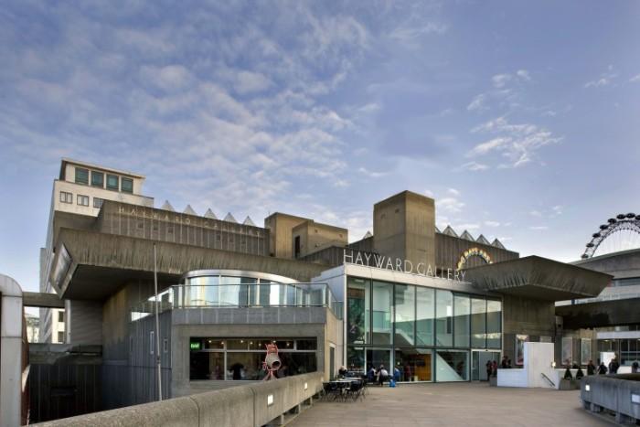 old brutalist design building, in dark grey, with large windows, the heyward gallery, in london england