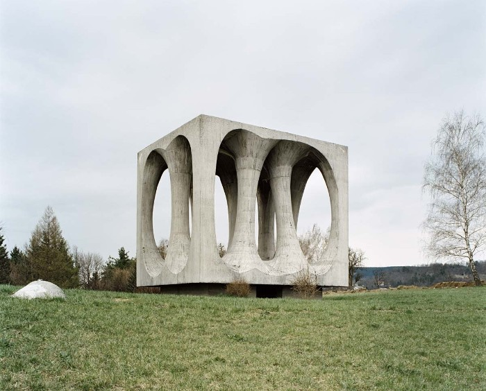brutalist art, a cube-shaped concrete monument, in ilirska bistrica former yugoslavia, in honor of the victims of ww II