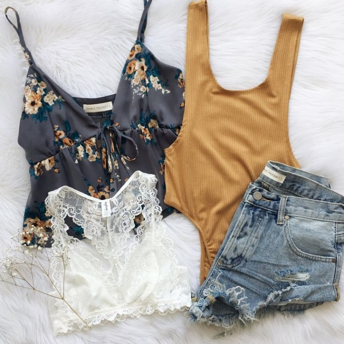 cutoff distressed light blue denim shorts, a white lace bralette, a mustard yellow body, how to wear a bralette, a black tank top with floral motifs
