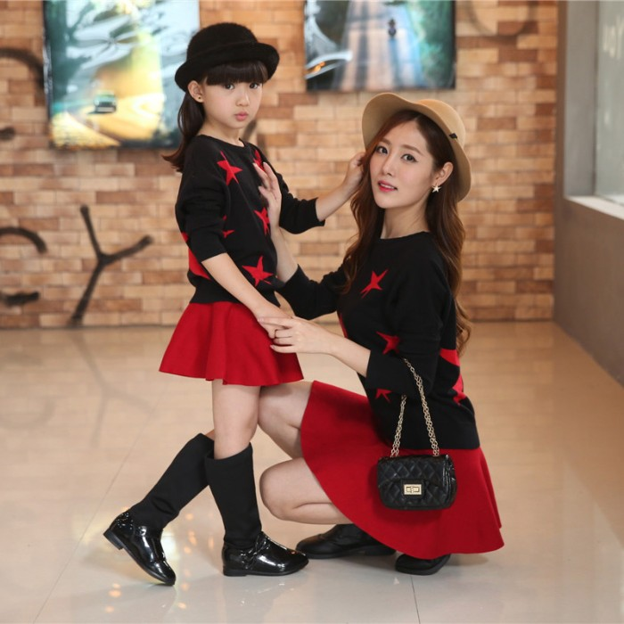 stars in red, on identical black jumpers, worn with red mini skirts, by a mother and a daughter, toddler thanksgiving outfit, coordinated looks