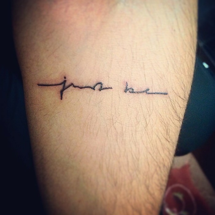 the words just be, written in black handwriting, tattooed on the back of a man's lower leg, inspirational and motivating