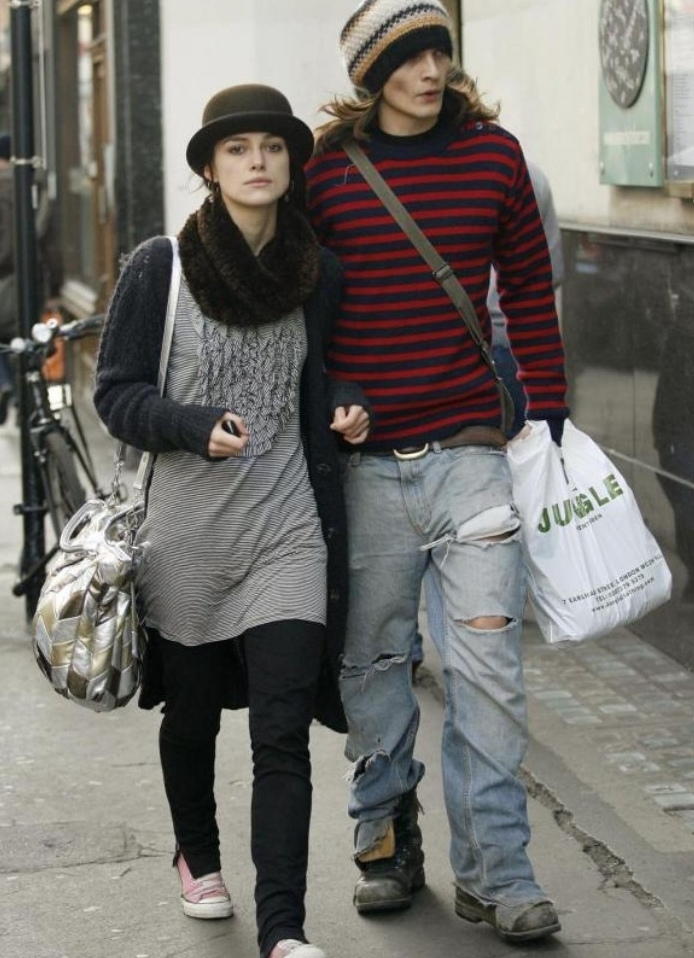 celebs wearing outfits, inspired by 90s and 80s grunge, keira knightley and her husband, walking side by side, in ripped jeans, and striped tops