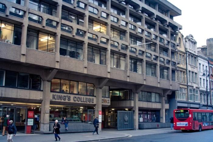 front view of king's college london's macadam building, dark beige brutalist structure, with multiple rectangular windows