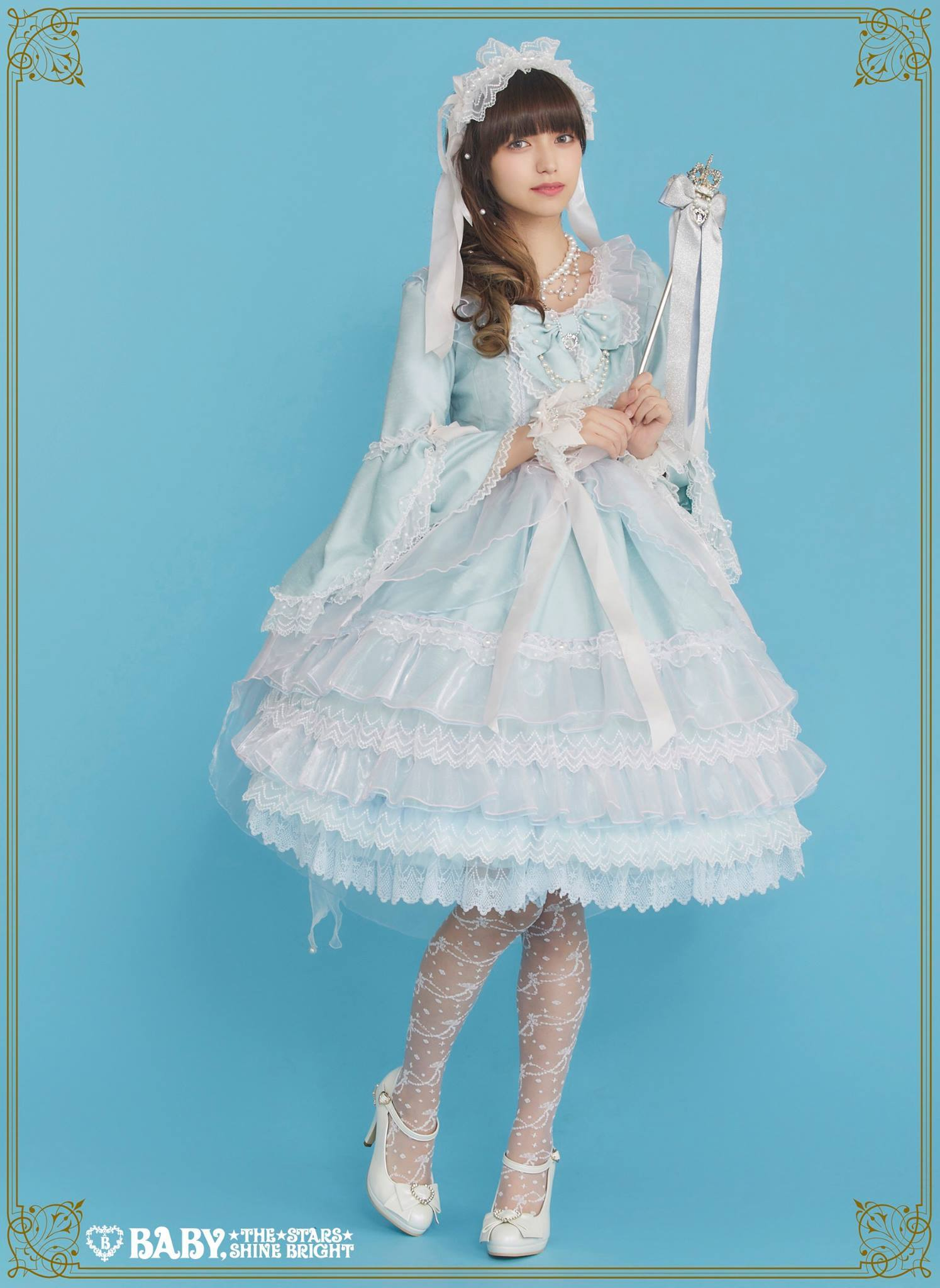 tights decorated with white patterns, and a knee-length pale blue dress, with lots of flounces and frills, worn by a slim brunette japanese woman
