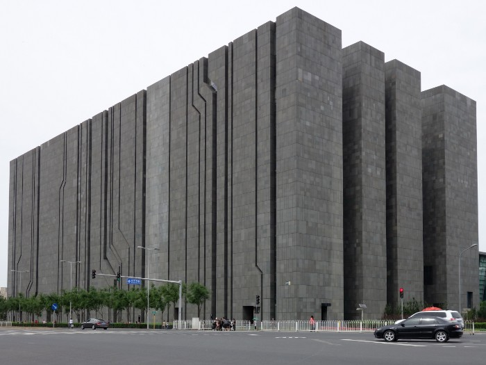 digital beijing building, a large rectangular structure, covered in dark grey concrete tiles, brutalism around the world, tall narrow sections