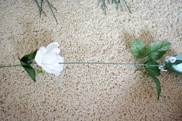 diys for girls, two fake roses, in white and pale blue, with long plastic stems, stuck together, to form a column