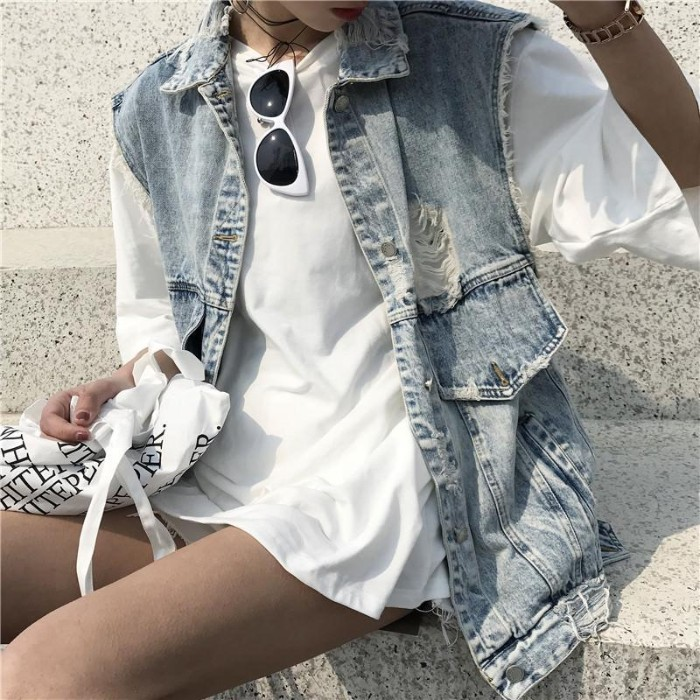 vest in pale blue, acid weash denim, with a long design, featuring pockets and rips, 90s grunge fashion, over a white oversized t-shirt, worn like a mini dress, by a slim woman