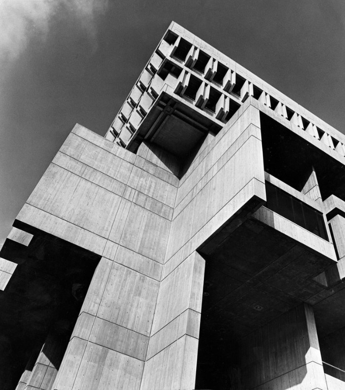 greyscale image of the boston city hall, seen from a low angle, iconic concrete architecture, qith angular elements