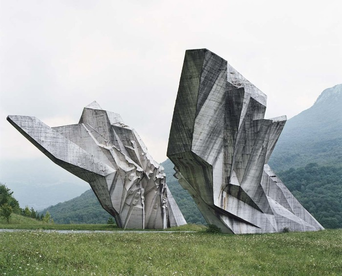 world war II brutalist monument, on the territory of former yugoslavia, concrete architecture statue, shaped like jagged shards