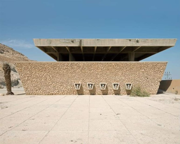 dead sea visitor center, in neve zohar israel, raw concrete structure, featuring beige natural stones, surrounded by desert