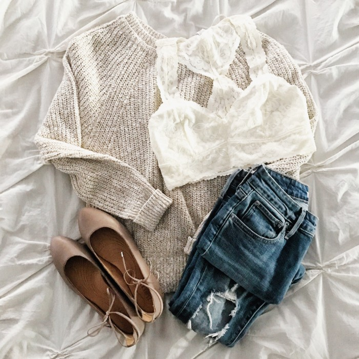 chunky knit sweater in pale cream, white lace bralette, ripped blue jeans, and a pair of light beige ballet flats, bralette outfit suggestions