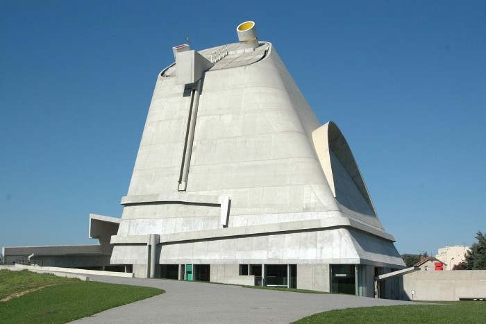saint-pierre building in firminy france, made of pale grey concrete, without any visible wondows, brutalist design
