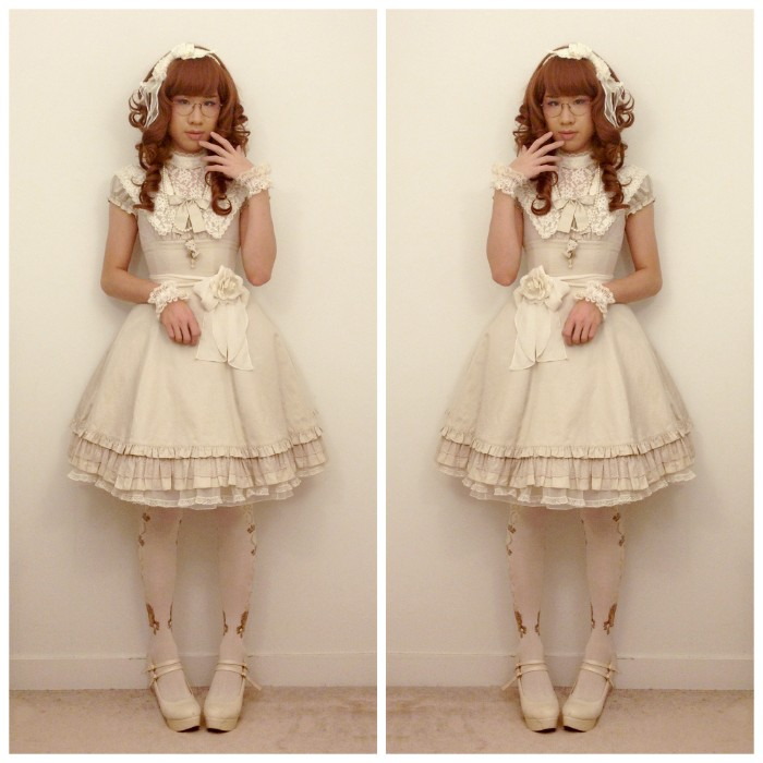 oatmeal colored lolita dress, with a cream lace bib detail, and a belt featuring a rose motif, worn over opaque, white and gold tights