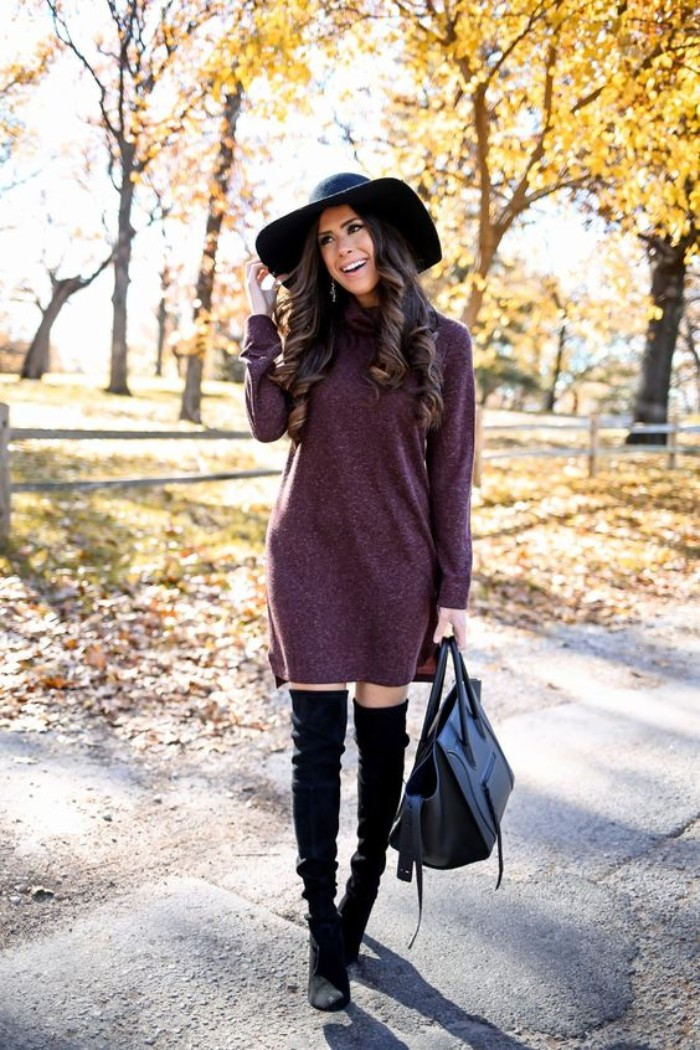 purple jumper dress, and black suede, over-the-knee boots, on a slim brunette woman, wearing a large black felt hat, comfy outfits