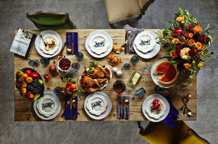 pie and turkey, fruit and butter, on a rectangular wooden table, set for six, seen from above, thanksgiving tablescape, bouquet with orange, red and yellow flowers
