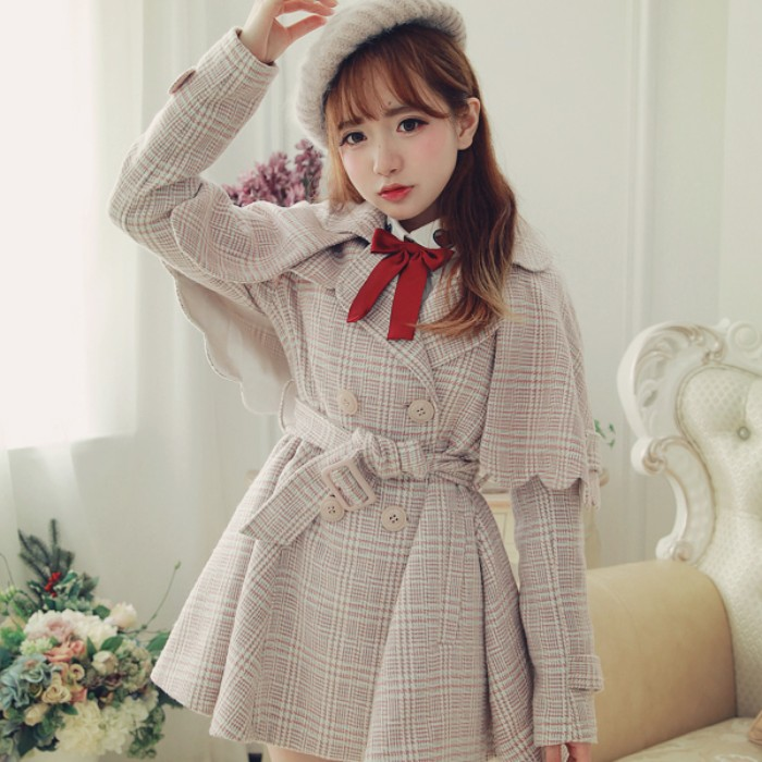 caped coat in beige plaid, with a red bow near the neck, worn by a brunette girl, in a white knitted baret, lolita fashion