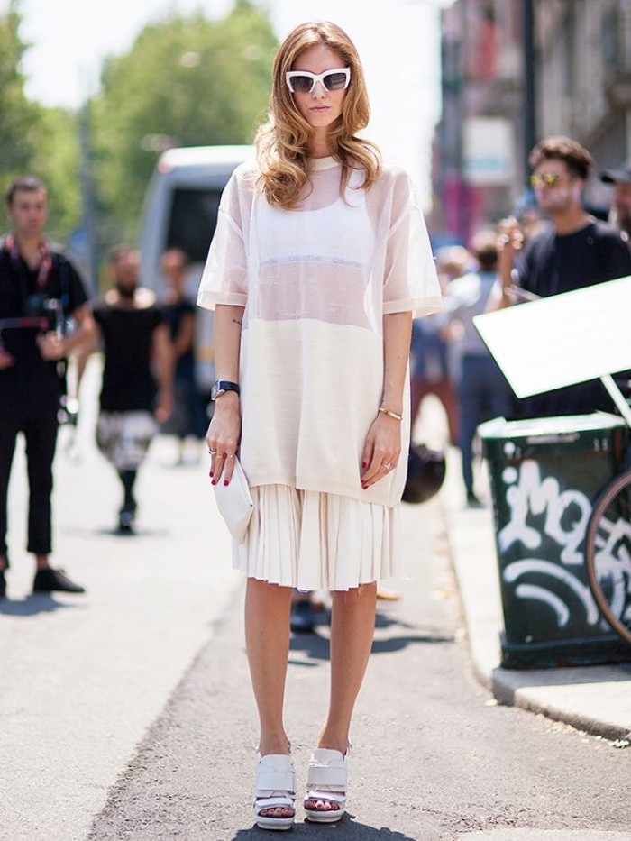 sunglasses with white frames, worn by a blonde woman, dressed in a pleated, white midi skirt, a white bralette, and a sheer white, oversized t-shirt, outfits with bralettes, white high heel, peep toe shoes
