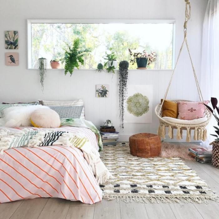 boho style room, with a woven, pale beige swing, and a bed in pastel colors, cute teen rooms, potted plants and a patterned rug, in white and beige and black