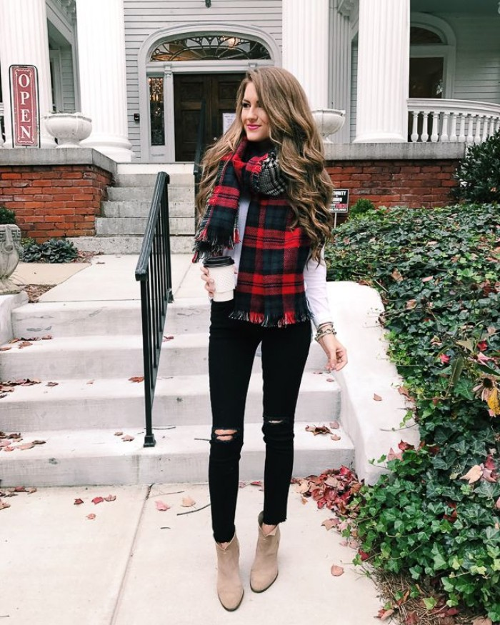 plaid blanket scarf, in red and black, combined with a white top, and worn over ripped, black skinny jeans, comfy outfits, light beige suede ankle boots