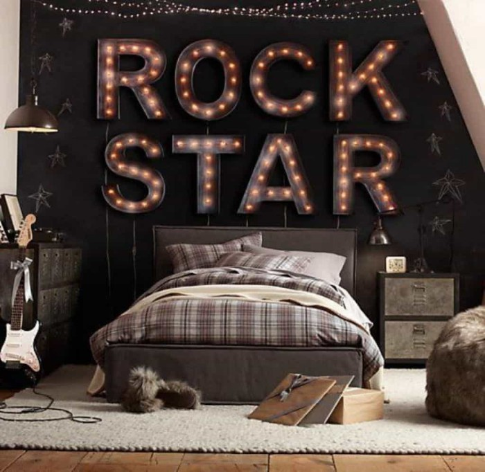 plaid brown and grey bedding, on a bed with two pillows, inside a room, with white and black walls, decorated with large illuminated letters, spelling the words rock star, cool beds for teens, pale grey carpet