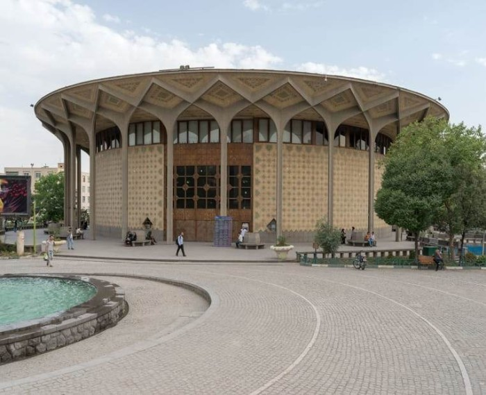 city theater of tehran, round building with an ornamental roof, supported by multiple concrete columns