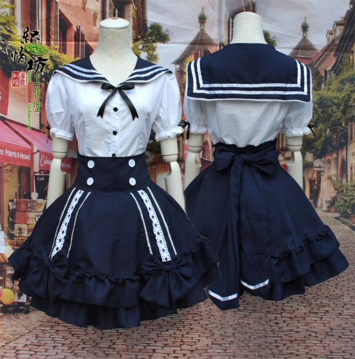 front and back view of a dress, in white and navy, resembling a sailor's uniform, lolita fashion, white lace incerts, ribbons and bows