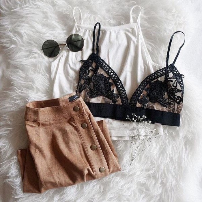 beige button-up skirt, white tank top, black embroidered see through bralette, and a pair of round sunglasses